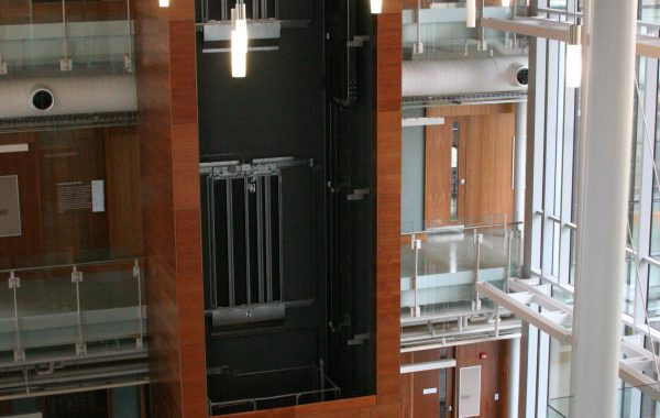 elevator surround with 3 floors of wood panels