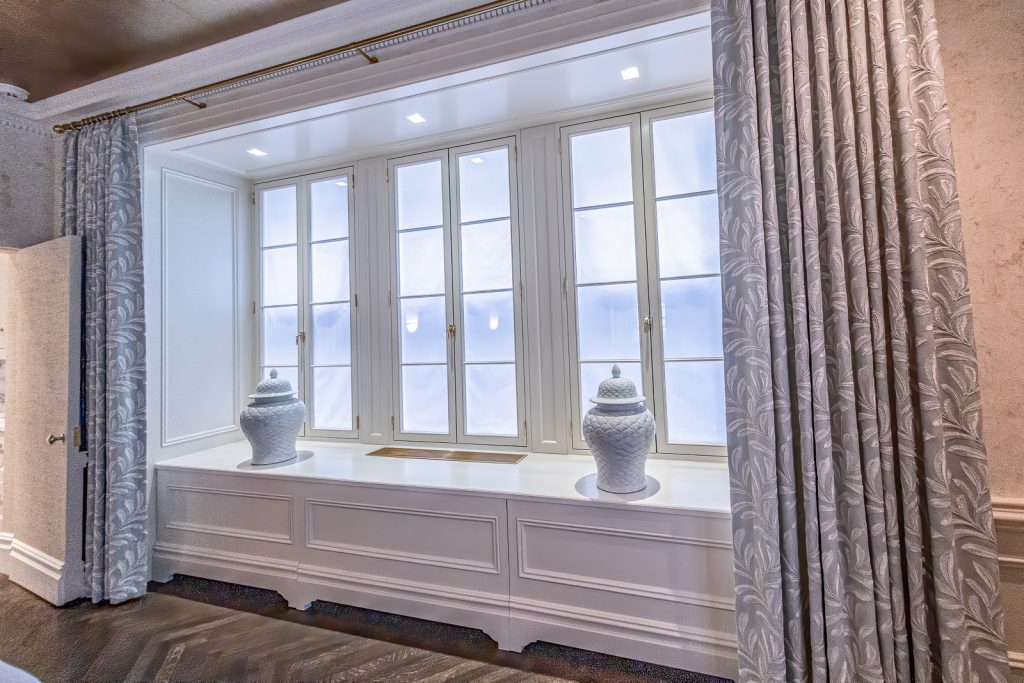 Dining room radiator cover integrated into window panels and back lighting screens